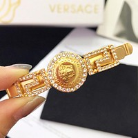 Versace New fashion human head diamond hairpin clip accessory Golden