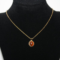 Gold Tone Necklace with Amber colored Center