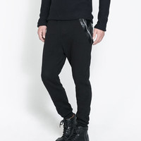 TROUSERS WITH FAUX LEATHER PATCHES - Trousers - Man | ZARA United States