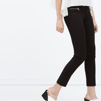 Seamed trousers with zips