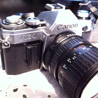 Canon AE-1 vintage camera.  35mm SLR.  1980s.  With strap.