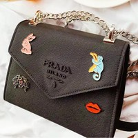 PRADA casual floating flower LOGO flip shoulder bag