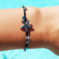 Crochet Beach Adjustable Bracelet with blue and clear glass beads and a starfish charm