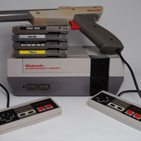 Nintendo Entertainment System (NES) Console with 4 Games