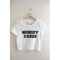 Nobody Cares White Graphic Crop Top