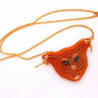 Squirrel embroidery - beaded necklace on a gold colored chain - orange embroidered seed bead jewelry - handmade beadwork - leather backside