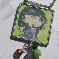 Hand stamped art pendant using Sunny Carvalho's adorable stamps