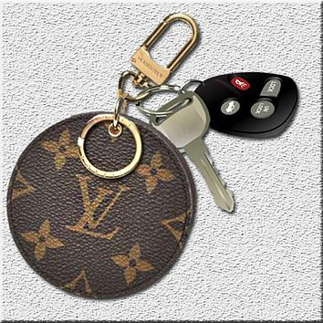 LV tide brand female retro classic old flower round coin purse key bag