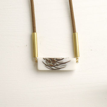 Bioresin and pinecone long necklace, brown cord
