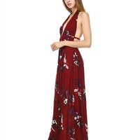 This sexy maxi dress features a gauze fabrication, floral print design throughout, plunging v-neckline with braided waist straps with hook closured, and connected halter strap. Finished with partially lined. Pair with Wide Brim Vegan Flappy Hat, fringe bag