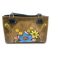 A classy premium leather handbag, hand-tooled and painted, with a complimentary two-tone design and soft leather lining | bohemian / western