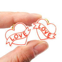 Love Banner Tattoo Heart Shaped Laser Cut Dangle Clip On Earrings in White from DOTOLY