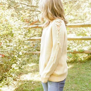 Enticing Lace Up Sweater by Blu Pepper