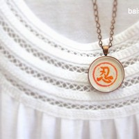 Endure Round copper necklace handprinted in red by Baisimu on Etsy