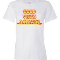 Good Vibes Activist Tshirt or tank with retro stripes.