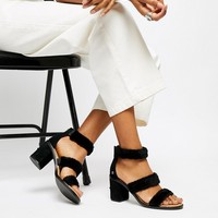 UGG Del Rey Black Triple Strap Fluffy Heeled Sandals at asos.com