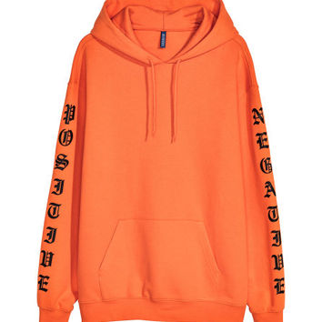 Hooded Sweatshirt with Motif - from H&M