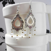 Chandelier earrings, with white glass beads, and bronze beads.