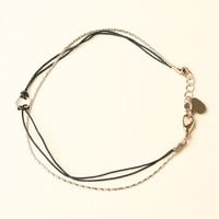 BLACK STRING AND GOLD CHAIN BRACELET WITH AN OPEN SQUARE CHARM