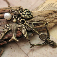 Hunger Games inspired charm necklace by trinketsforkeeps on Etsy