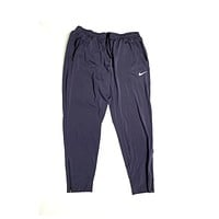 Nike Women's Thermal Essential Woven Jogger Pants Purple