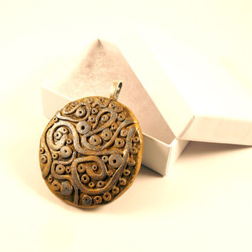 Gold and Silver Round Abstract Pendant