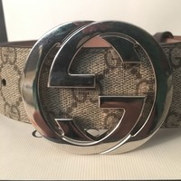 Beige Gucci belt with silver buckle