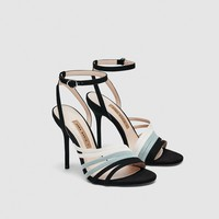 HIGH-HEEL SANDALS WITH CONTRASTING STRAPS DETAILS