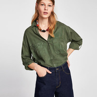 FLOWY SHIRT WITH POCKETS DETAILS