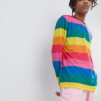 ASOS DESIGN relaxed long sleeve t-shirt with rainbow stripe at asos.com