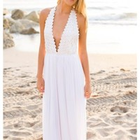 Julia - White halter maxi dress with low deep neckline with lace detail.