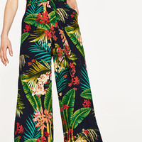TROPICAL PRINT TROUSERS WITH BELT DETAILS