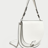 OVAL CROSSBODY BAG WITH FASTENING DETAIL DETAILS