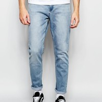 Cheap Monday | Cheap Monday Jeans Dropped Slim Tapered Fit Stonewash Blue at ASOS