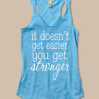 It doesn't get easier, you get stronger. at ease designs usmc navy army usaf uscg clothing