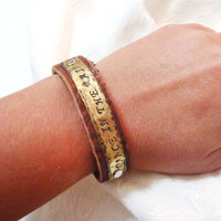 Dancing in the rain - handstamped brass blank with leather cuff bracelet and snap closures - blank riveted to leather - inspiring song lyric