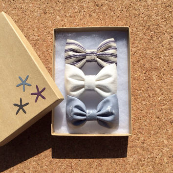 Nautical pinstripe, creamy white and grey arrow hair bows from Seaside Sparrow. Perfect gift.