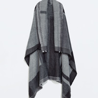 Geometric checked poncho