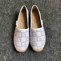 Gucci Dual G V-pattern flat-soled straw-woven fisherman's shoes and slippers
