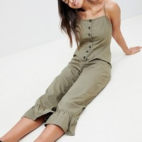 ASOS DESIGN cotton frill hem jumpsuit with square neck and button detail at asos.com