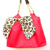 Stay a fashion beat ahead of the trend with this solid pink color faux-leather BOW-LICIOUS Tote by Betsey Johnson. Featuring a flirty bow and signature hardware, it's certain to set any look aflutter.