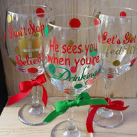 Don't Stop Believin, He Sees You When You're Drinking, and Lets Get Elfed Up wine glasses