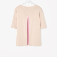 Top with pleated back