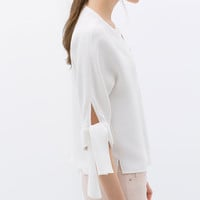 White V-neck top with knotted sleeve | ZARA