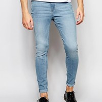 Cheap Monday | Cheap Monday Jeans Mid Spray Extreme SuperStretch Skinny Fit Stone Bleach at ASOS
