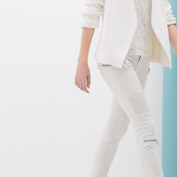 SKINNY TROUSERS WITH SEAMS AND ZIPS