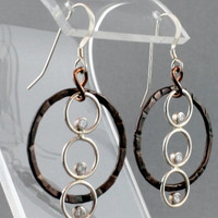 Elegant sterling silver and copper earrings with cubic zirconia stones