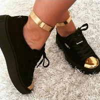 PUMA The black head of gold metal head shoes