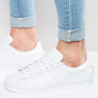 adidas Originals Superstar Sneakers In White B27136 at asos.com
