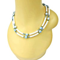 Multi Strand Milk Glass Puffy Disks and Crystals with Carved Rose Beads